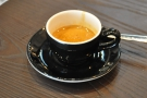 And the output: a great espresso in a classic black cup.