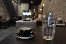 I also got a glass of water without asking. Here espresso and water survey the room.