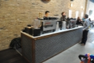 The two espresso machines have their own counter. That's the owner, Joe, on the right.