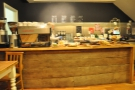 The counter, as seen from my seat. Look!  it's bowed a little in the middle... All that cake, see.
