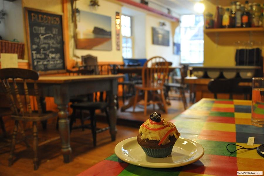 My cupcake surveys the cafe