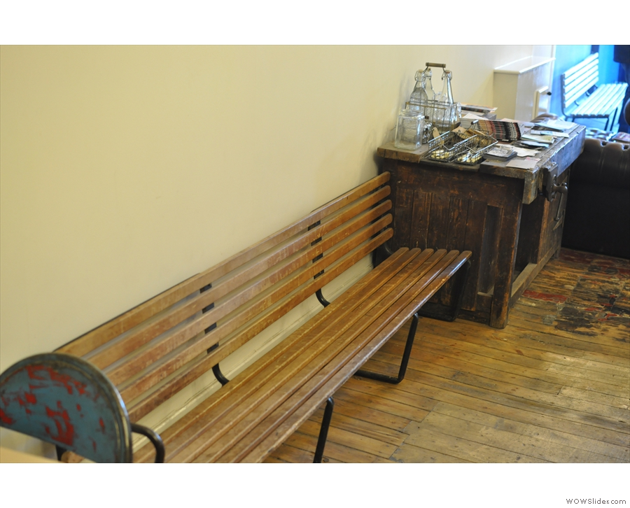 More seating: a garden bench opposite the counter.
