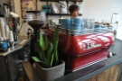 The bright-red La Marzocco and its blue cups provide a splash of colour.