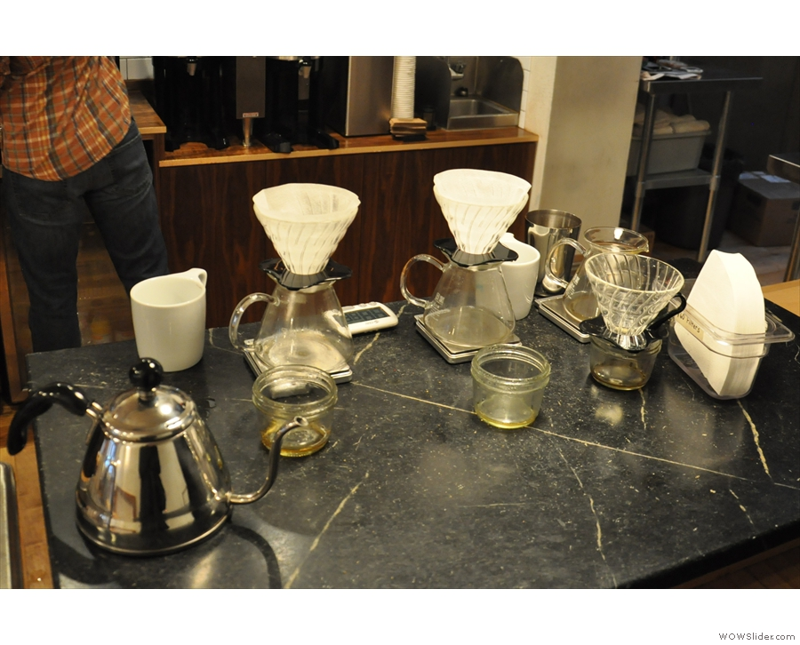 The brew bar, which is on the right-hand side of the counter, towards the back.