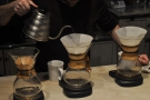 Here two Chemex are being prepared at the same time. The second pour begins.