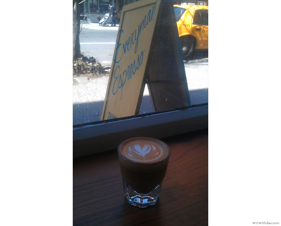 Here my cortado admires the sign outside...