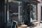 Everyman Espresso, in the sun, on West Broadway