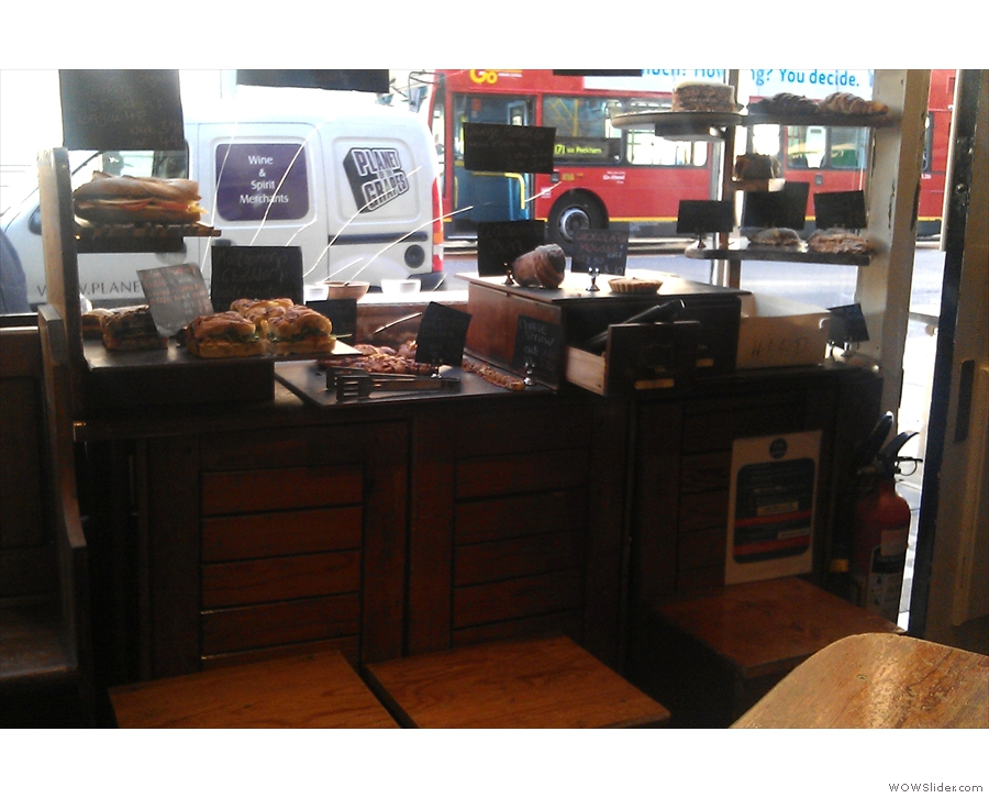 A view of the window on a previous visit. Cakes galore!