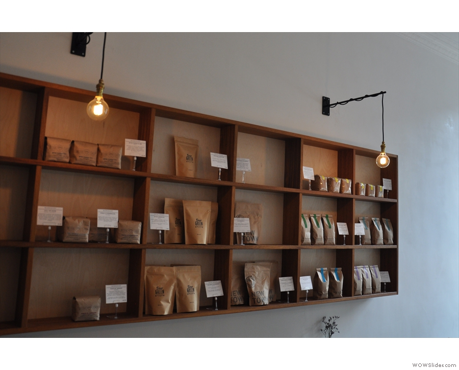 More bare bulbs, this time illuminating the massed ranks of coffee beans for sale.
