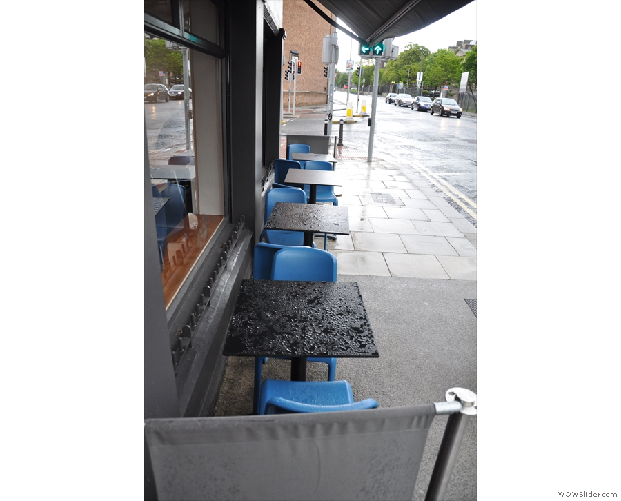There's plenty of outside seating: these four tables to the right of the main door...