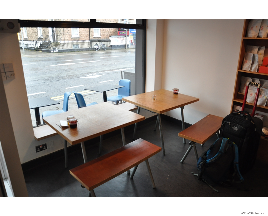 Let's go inside: there are these two tables in the window to the left of the door...