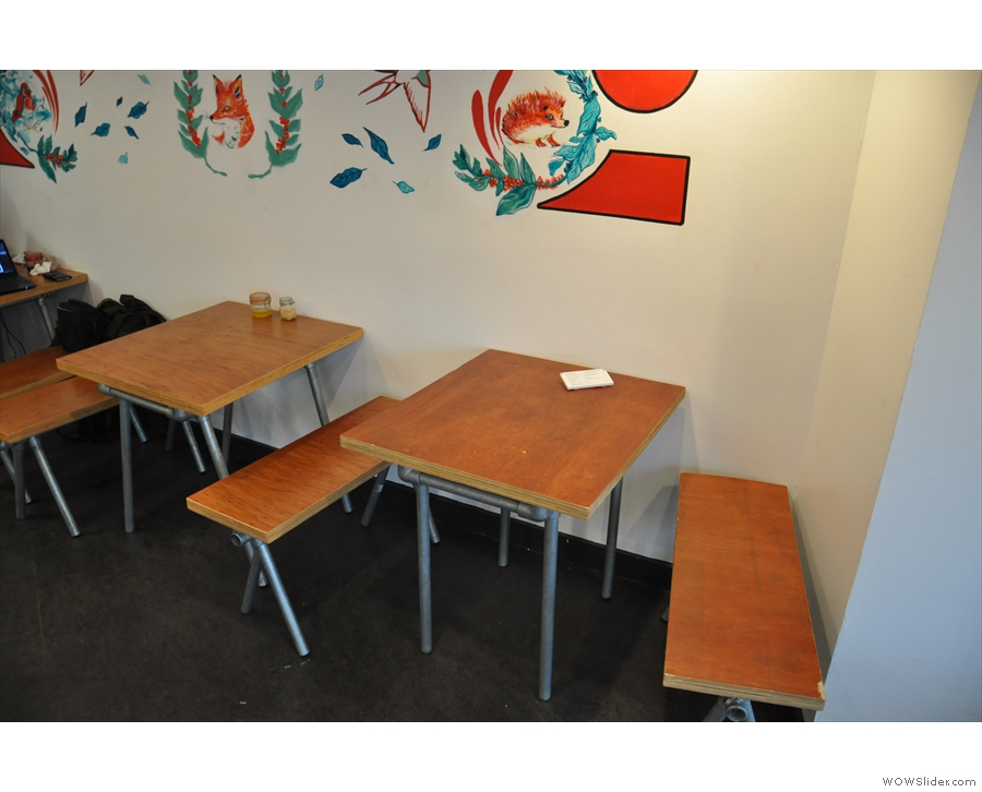 Two of the three tables against the far wall.