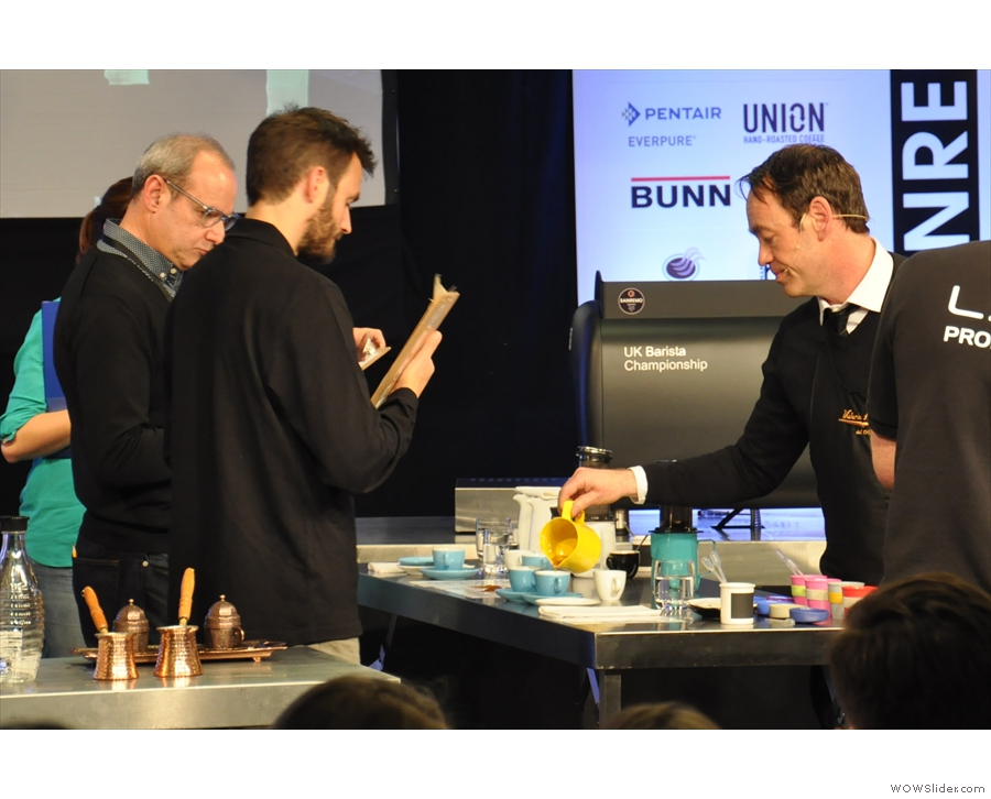 Gwilym dispenses his coffee to the judges.