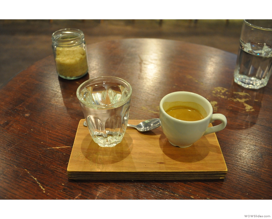 My 3FE espresso, beautifully presented on this wooden tray with a glass of water.