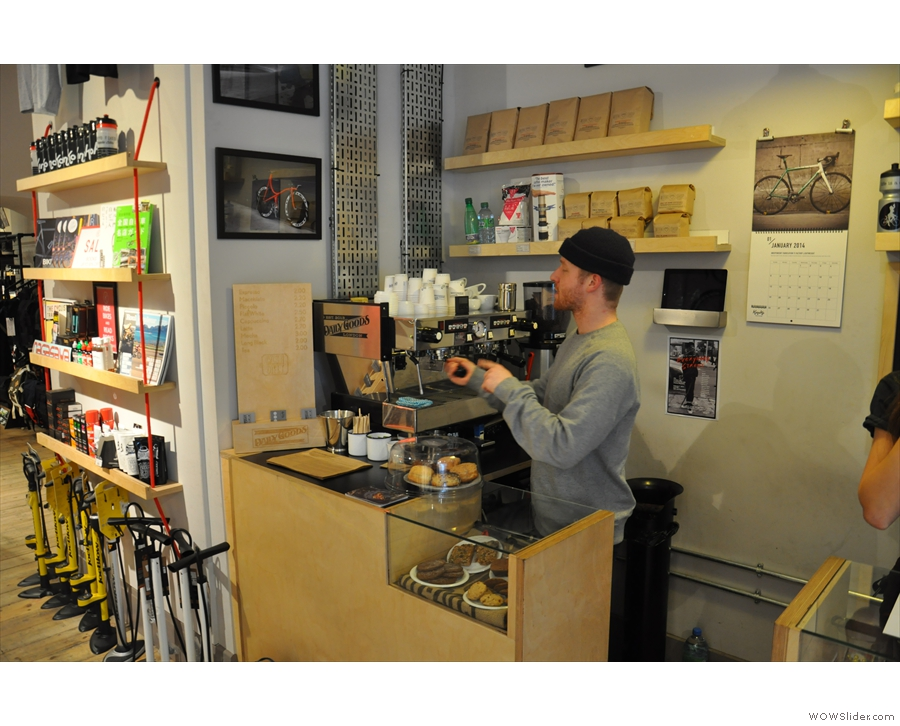 Just inside the door you'll find Carter, the owner/barista of Daily Goods, behind his counter.