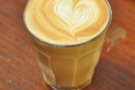 The final output: a decaf piccolo with superb latte-art.