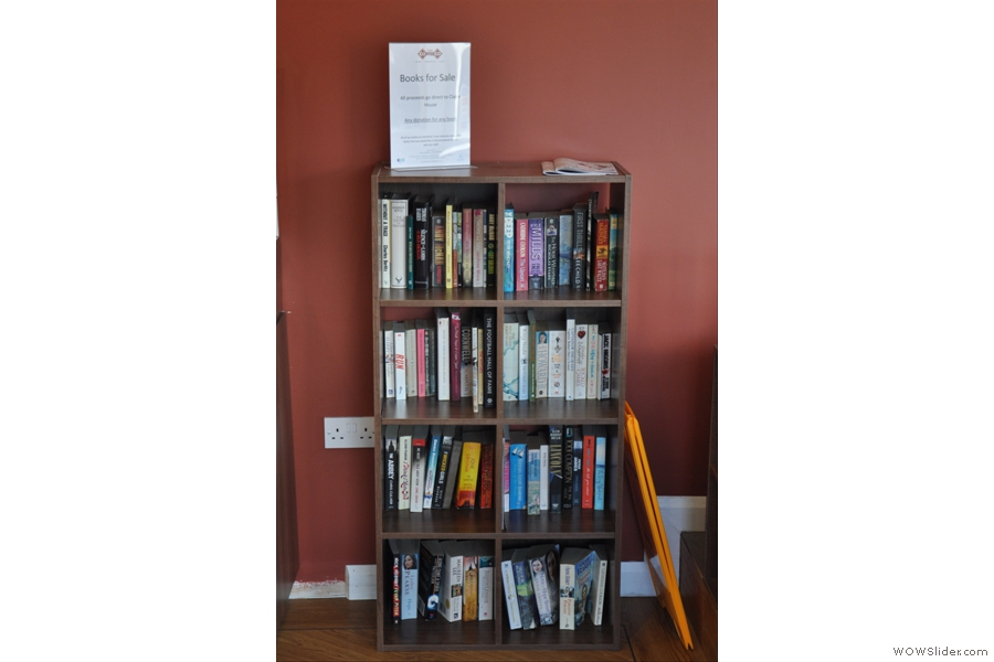 What's that I see. A book shelf? With all the sales going to Claire House, a local children's hospice. What a great idea! And look, a power socket! So that's where they've hidden it :-)
