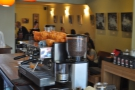 A view across the counter of the seating area at the back. That's my friend Kate hiding behind the coffee grinder...