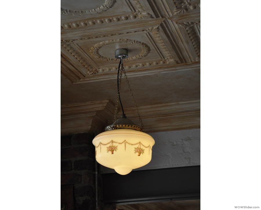 An example of one of the lights hanging from the panelled ceiling...