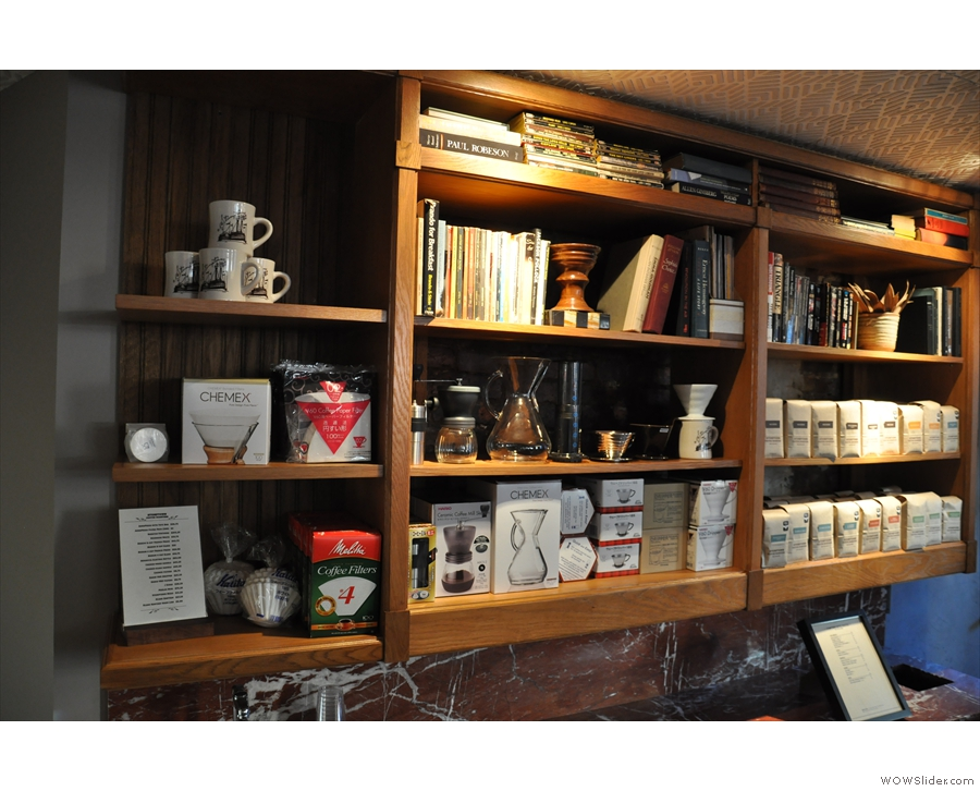 The shelves of coffee and coffee-making kit at the back.