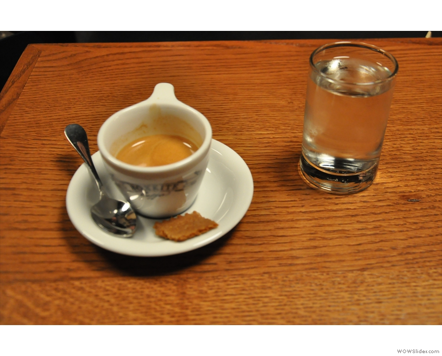 The output: my espresso with cookie and glass of water (which was constanty topped-up)