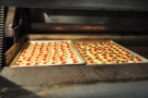 Some of the Italian biscuits being cooked in one of the huge ovens.