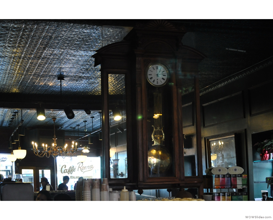 The mirror and the pendulum clock at the back of Caffe Roma.