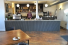 The vast, empty space in front of the counter. Baristas Austin & Brian wait behind the counter, exuding an air of confidence.