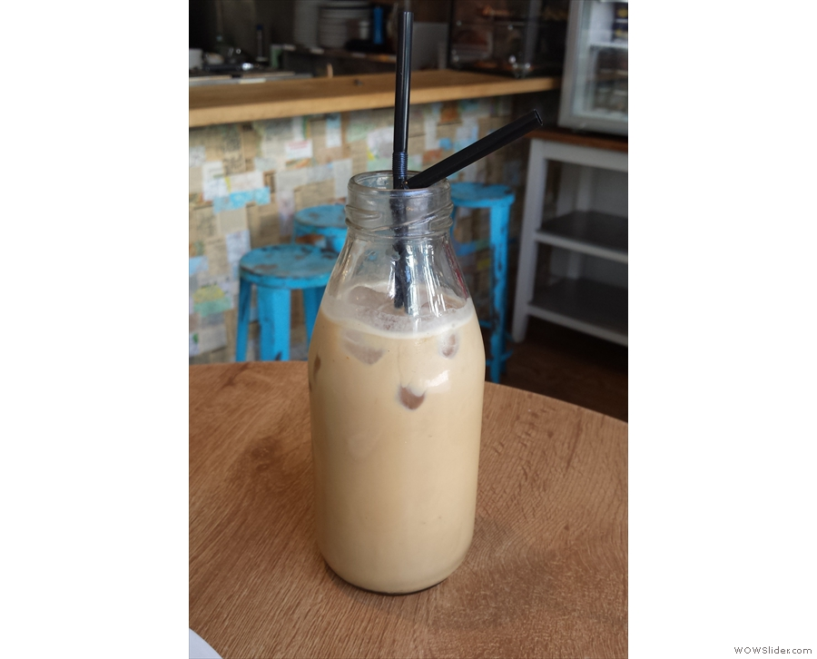 Kate's iced latte came in the cutest milk bottle...