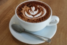 ... while my (decaf) cappuccino revels in its artwork.