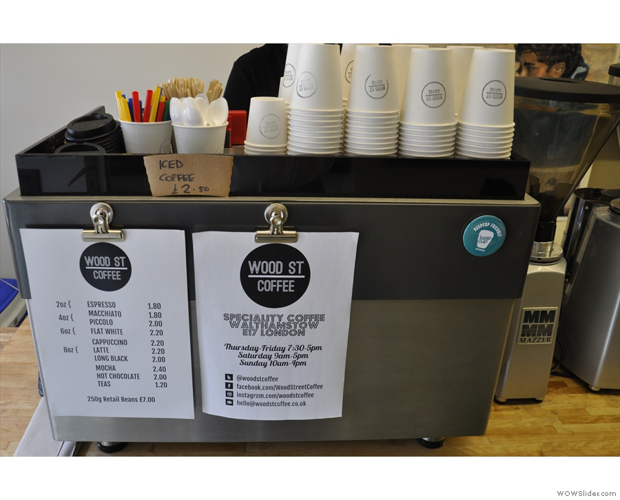 The menu is helpfully pinned up on the two-group La Marzocco.