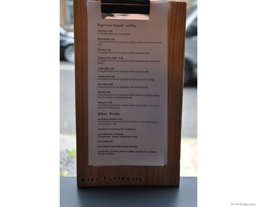 A more expansive version of the drinks menu is in the window.