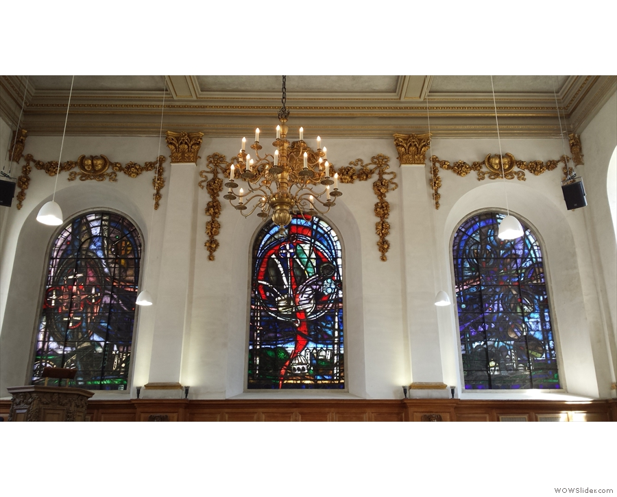 Three stained-glass windows soar above the alter.