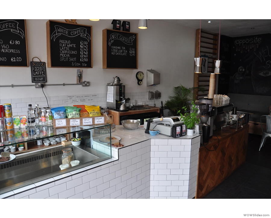 The counter itself is a two-part affair: food (tiled) and coffee (wood).