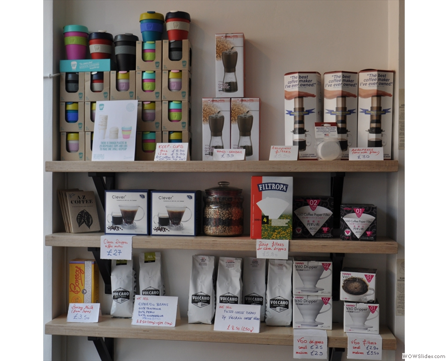 The opposite wall is given over to a shelf full of coffee beans and kit for sale.
