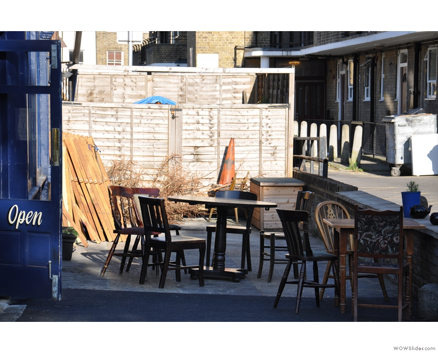 The small outdoor seating area to the right.