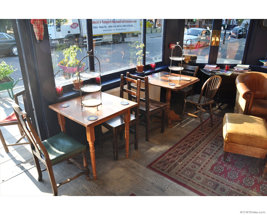 To your left as you come in, another two two-person tables.