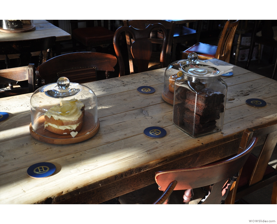 One of the best features is how the cakes share the tables with you...