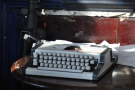 There's a neat typewriter on the desk behind the chairs.