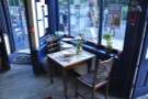 One of the two-person tables by the windows. This is immediately to your right...