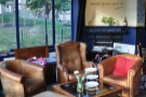 Another view of the three armchairs. What's that written on the wall?