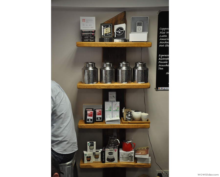 A shelf of coffee and coffee-making kit. And tea.