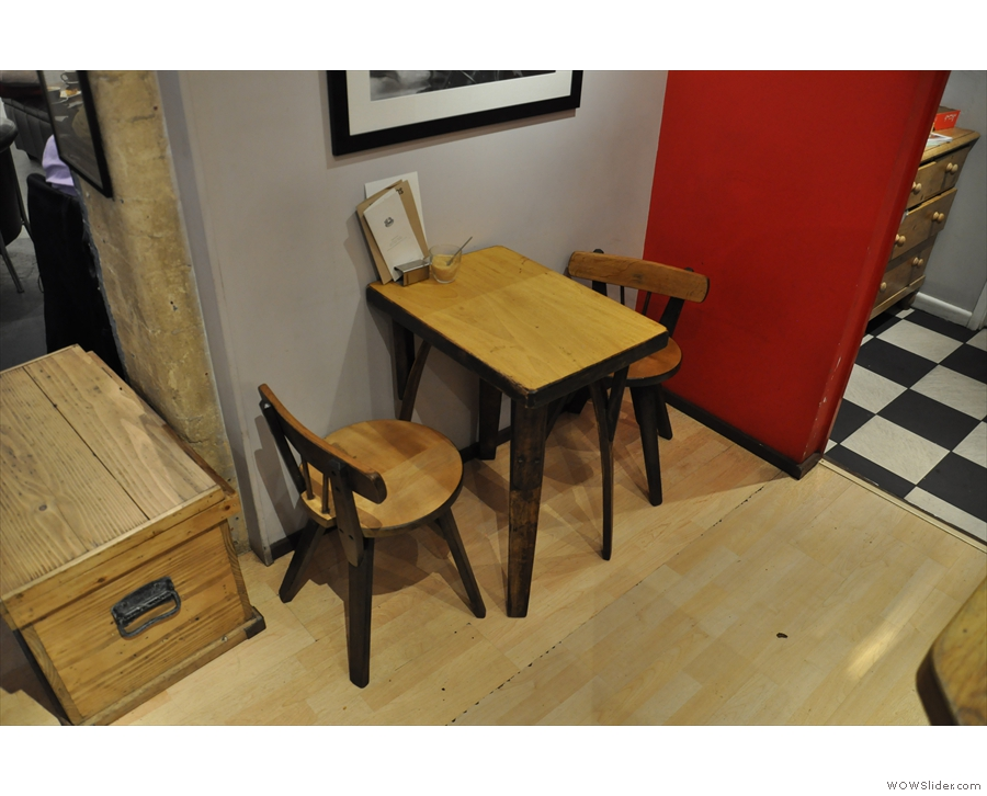 There are also lots of other seating options, such as this little table in the corner...
