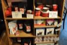 A shelf of coffee and coffee-making kit.