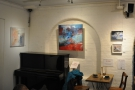 ... and the art sales table next to the piano.