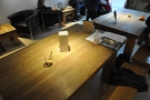 A rare shot of one of the main tables when it was unoccupied.