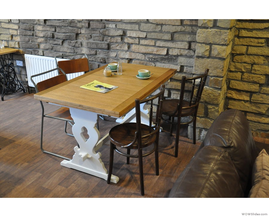 There are plenty of seating options, such as this table just beyond the sofas...