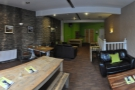A panoramic view of the upstairs from by the windows.