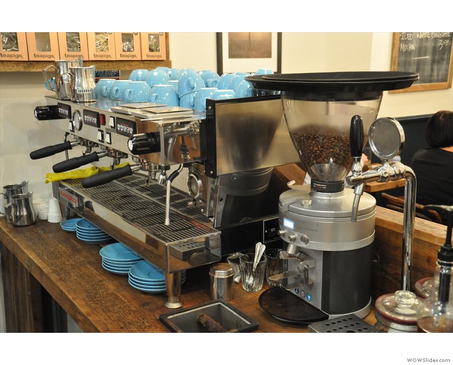 The La Marzocco espresso machine and grinder in close-up.