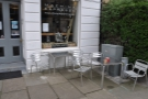 The outdoor seating at Machina Espresso. Nicely situated hedge!